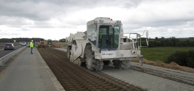 Photo of mixing cement in the widened road section.