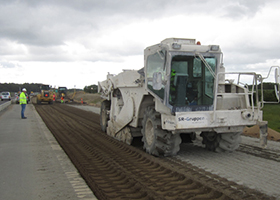 Mixing cement in the widened road section.