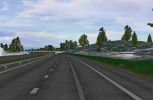 Simulated electric road at Hällered, where the electricity is transferred via a rail in the roadway.