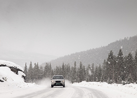 Winter road in snowstorm