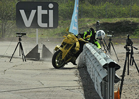 Guardrail crash test with motorcycle