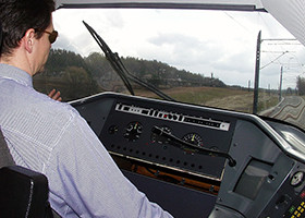 Image of a man driving a tram.
