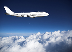 Jumbo jet aviation in level flight high above clouds