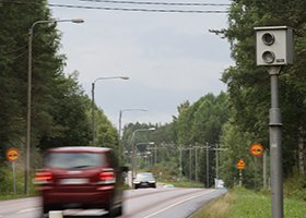 Car passing an automatic speed camera