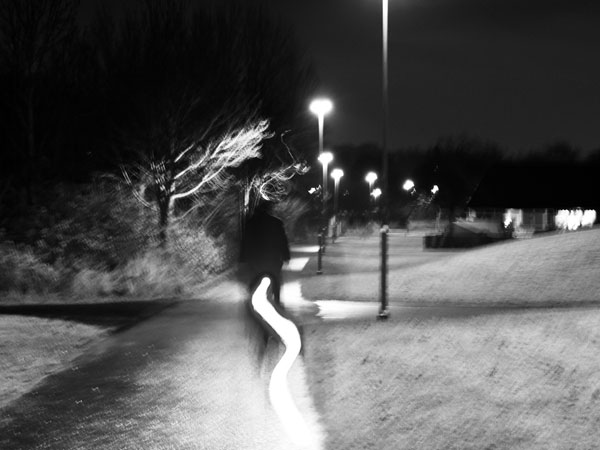 How can outdoor lighting improve the quality of walking and cycling trips at dusk and darkness.